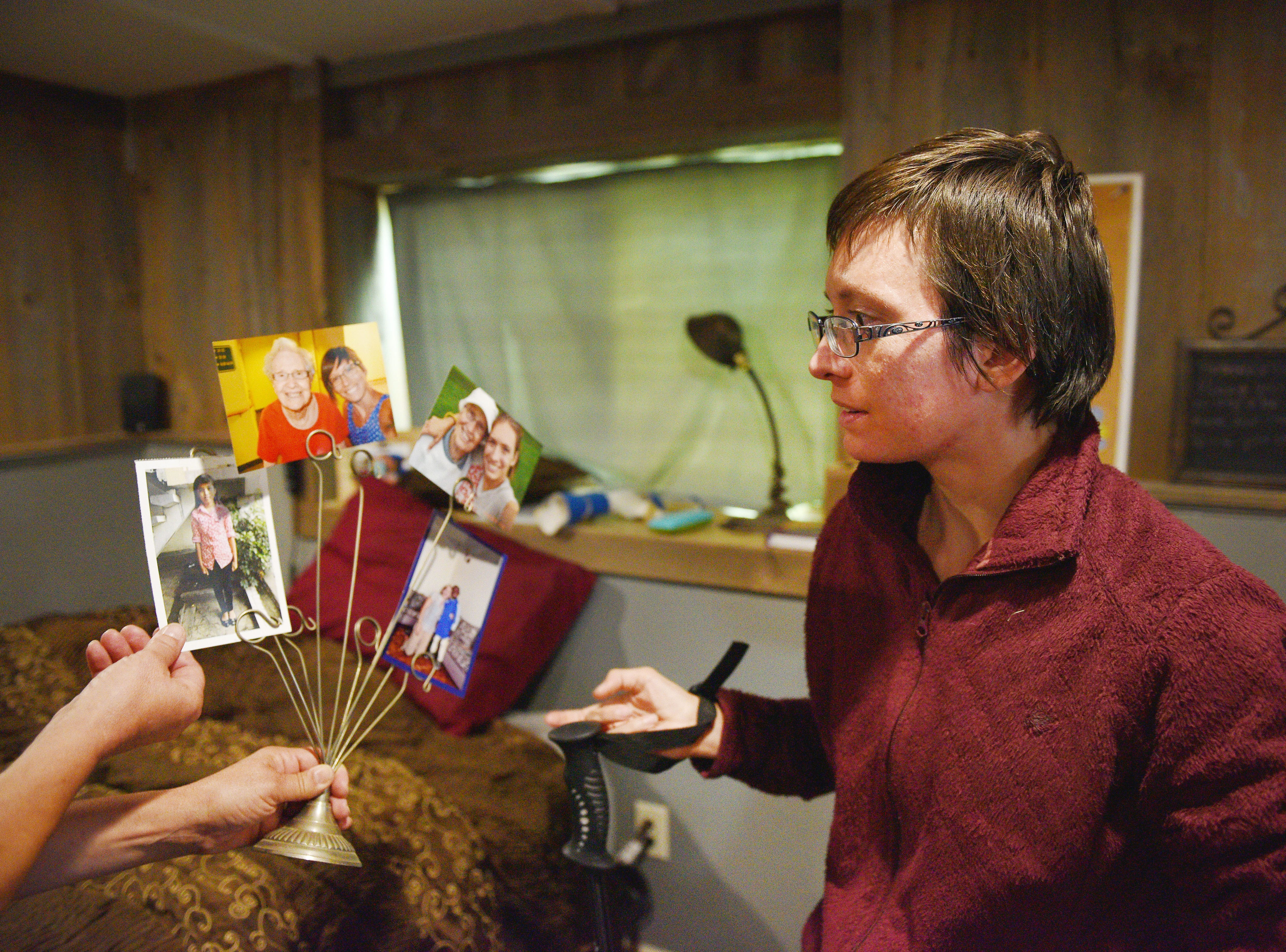 Ashley Van Hemert shows photos of children her and her late grandmother sponsor, Friday Sept. 28, at her home in Sioux Falls. Ashley said her grandmother and her sponsored children. When her grandmother died, she took over her grandmother's sponsorship.
