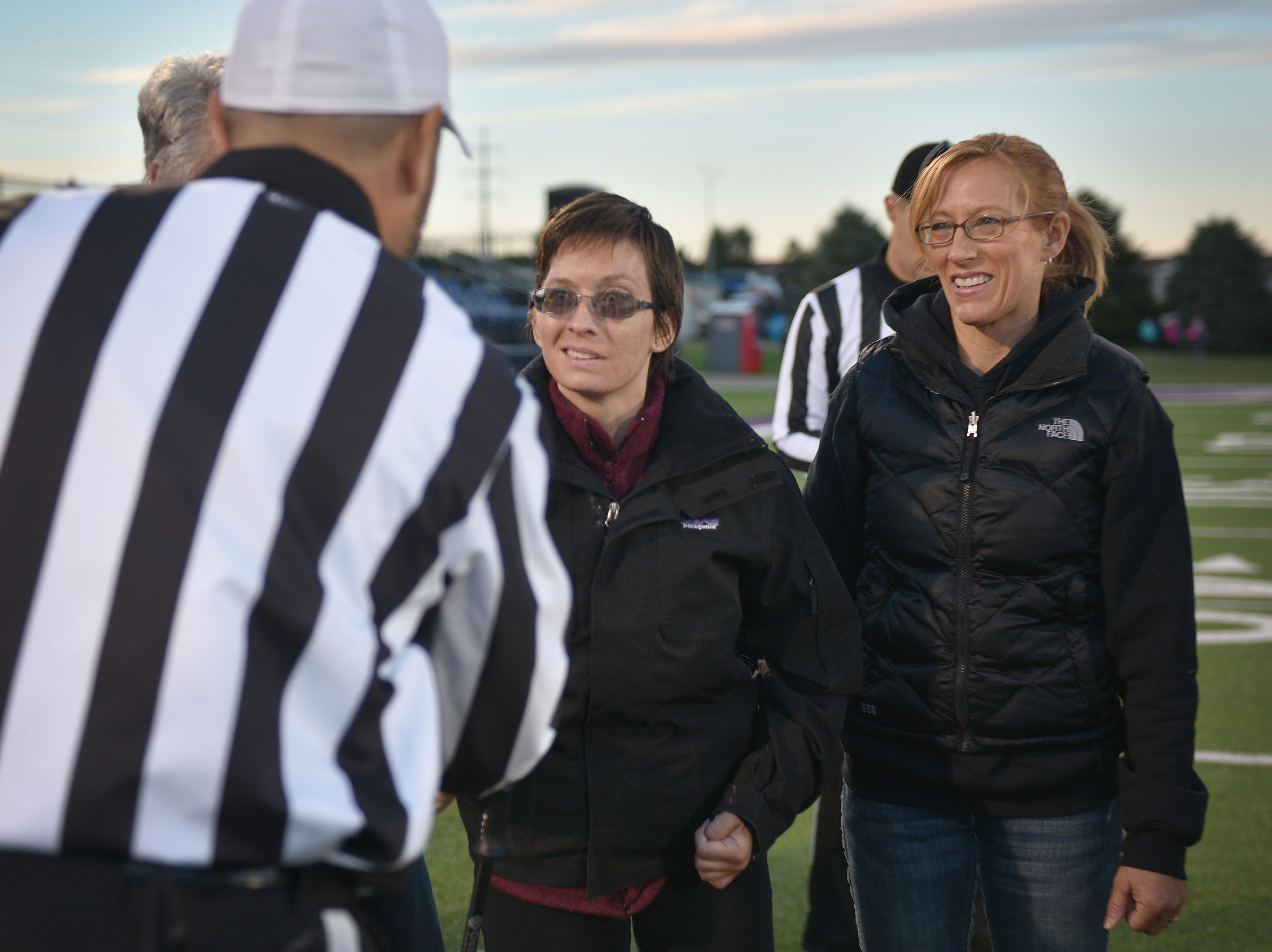 Ashley Van Hemert does the coin toss for the Sioux Falls Christian game, Friday Sept. 28, at Bob Young Field University Of Sioux Falls Stadium.