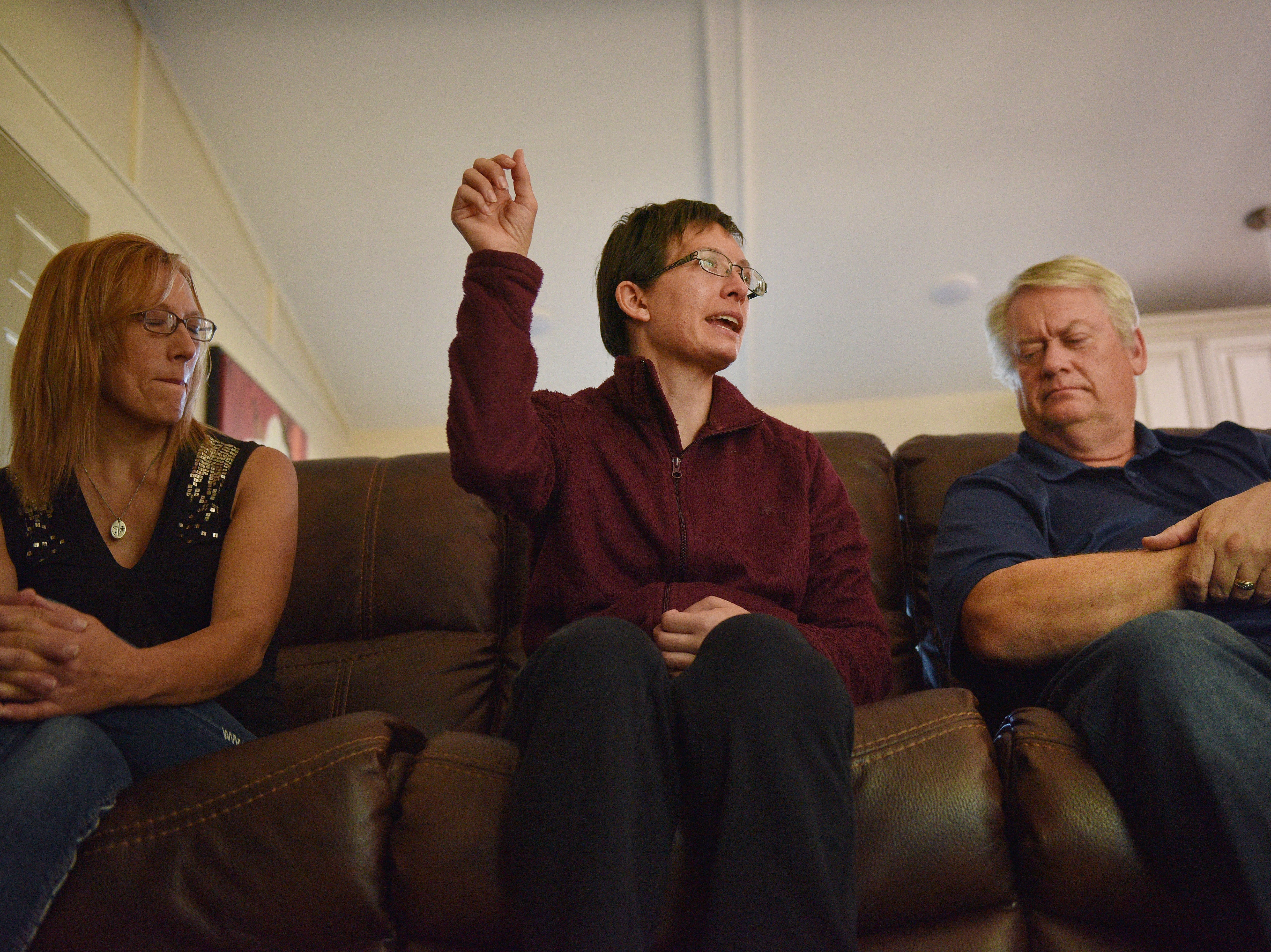 Ashley's mom Linda Van Hemert, from left, Ashley and her dad Lyle talk about Ashley's recovery Friday Sept. 28, at their home in Sioux Falls. Ashley talks about how it's harder for her to move her left arm now so she is focusing on getting to be as strong as her right arm.