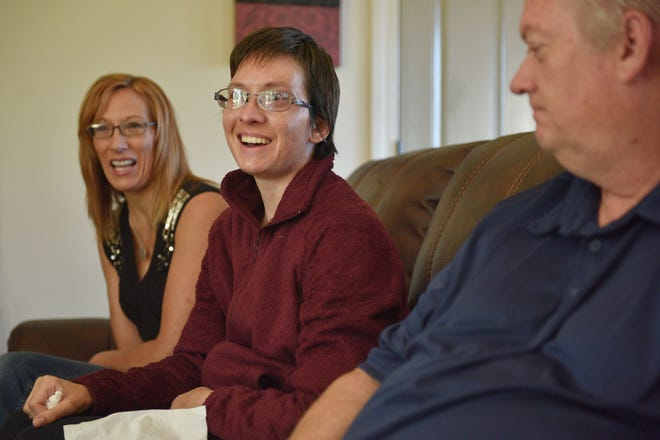 Ashley Van Hemert recalls funny moments when she was learning to walk and talk again with her parents Linda and Lyle, Friday Sept. 28, at their home in Sioux Falls.