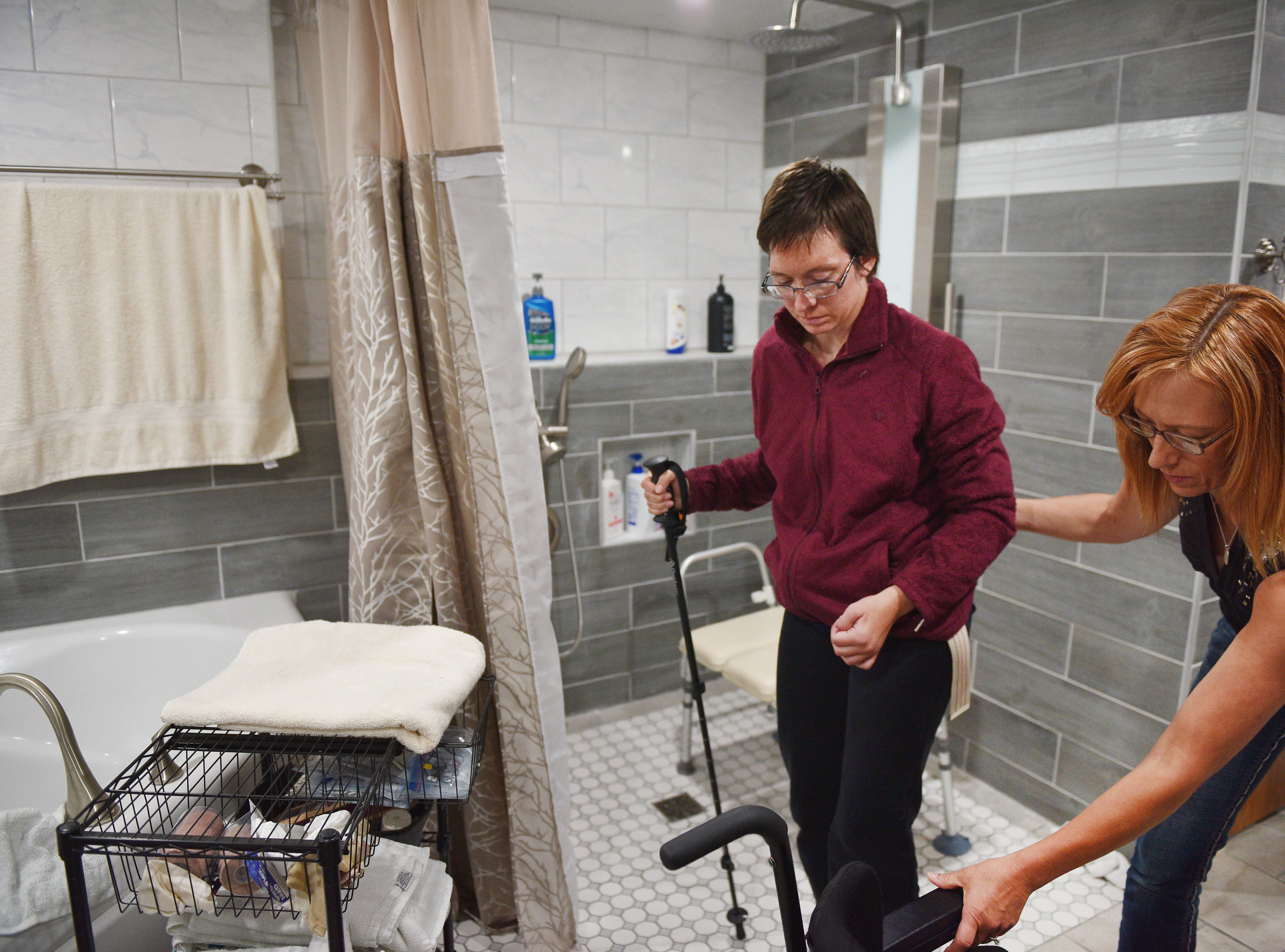 Ashley Van Hemert talks about the remodeling her mom and dad did to the downstairs basement to make it handicap accessible, Friday Sept. 28, at their home in Sioux Falls.