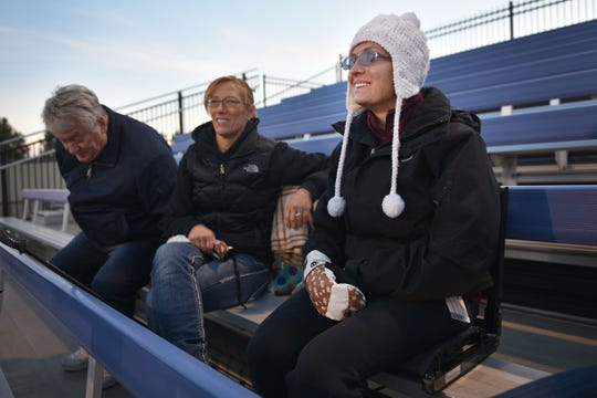 Ashley Van Hemert sits with her parents Linda and Lyle to watch the Sioux Falls Christian game after she does the coin toss, Friday Sept. 28, at Bob Young Field University Of Sioux Falls Stadium.