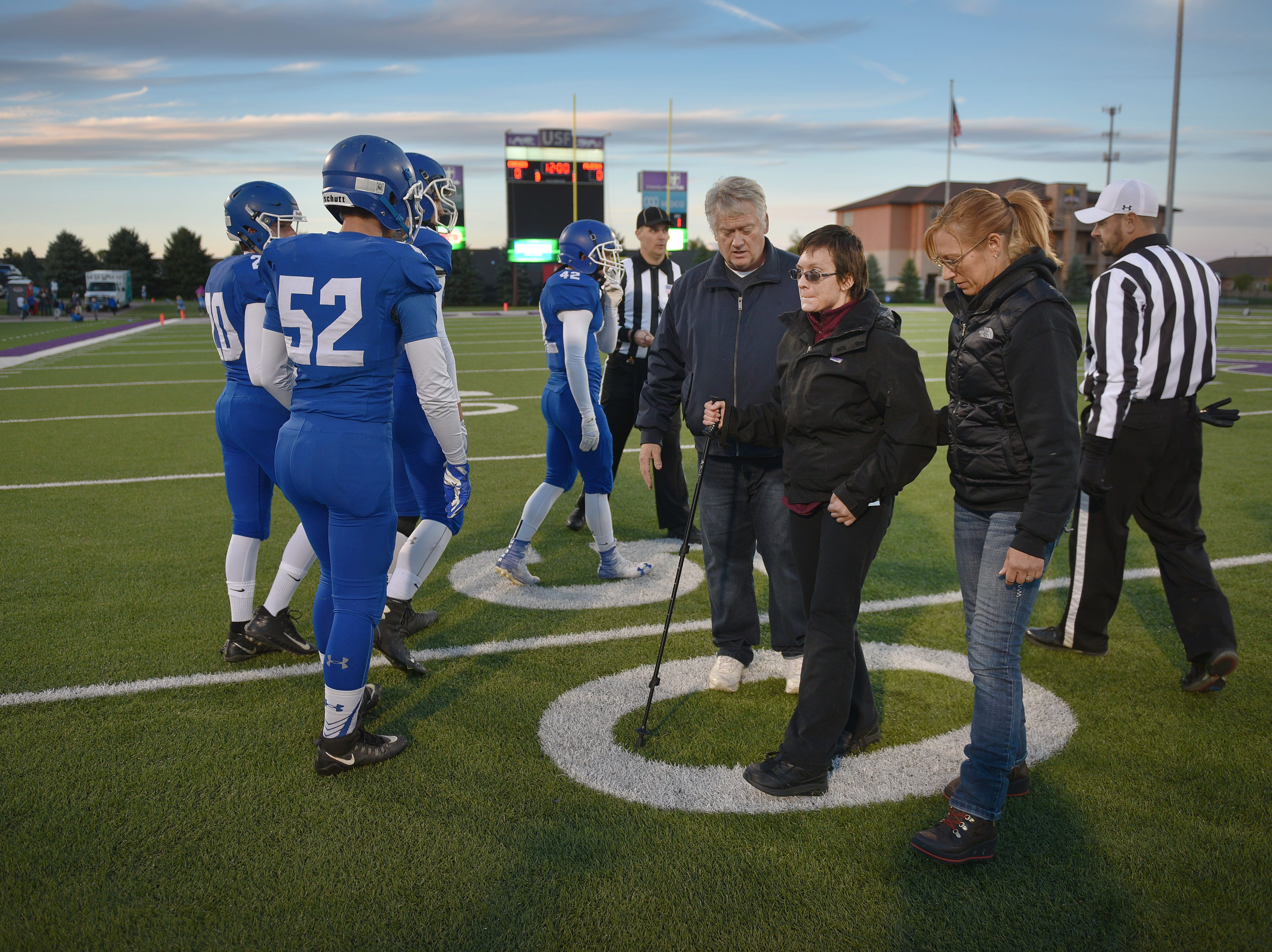 Ashley Van Hemert walks off the field after the coin toss for the Sioux Falls Christian game, Friday Sept. 28, at Bob Young Field University Of Sioux Falls Stadium.