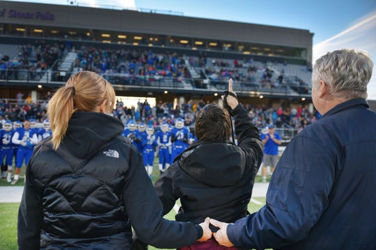 Ashley Van Hemert points to the sky after she does the coin toss for the Sioux Falls Christian game, Friday Sept. 28, at Bob Young Field University Of Sioux Falls Stadium.