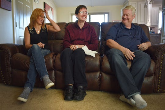 Ashley's mom Linda Van Hemert, from left, Ashley and her dad Lyle talk about Ashley's recovery Friday Sept. 28, at their home in Sioux Falls.