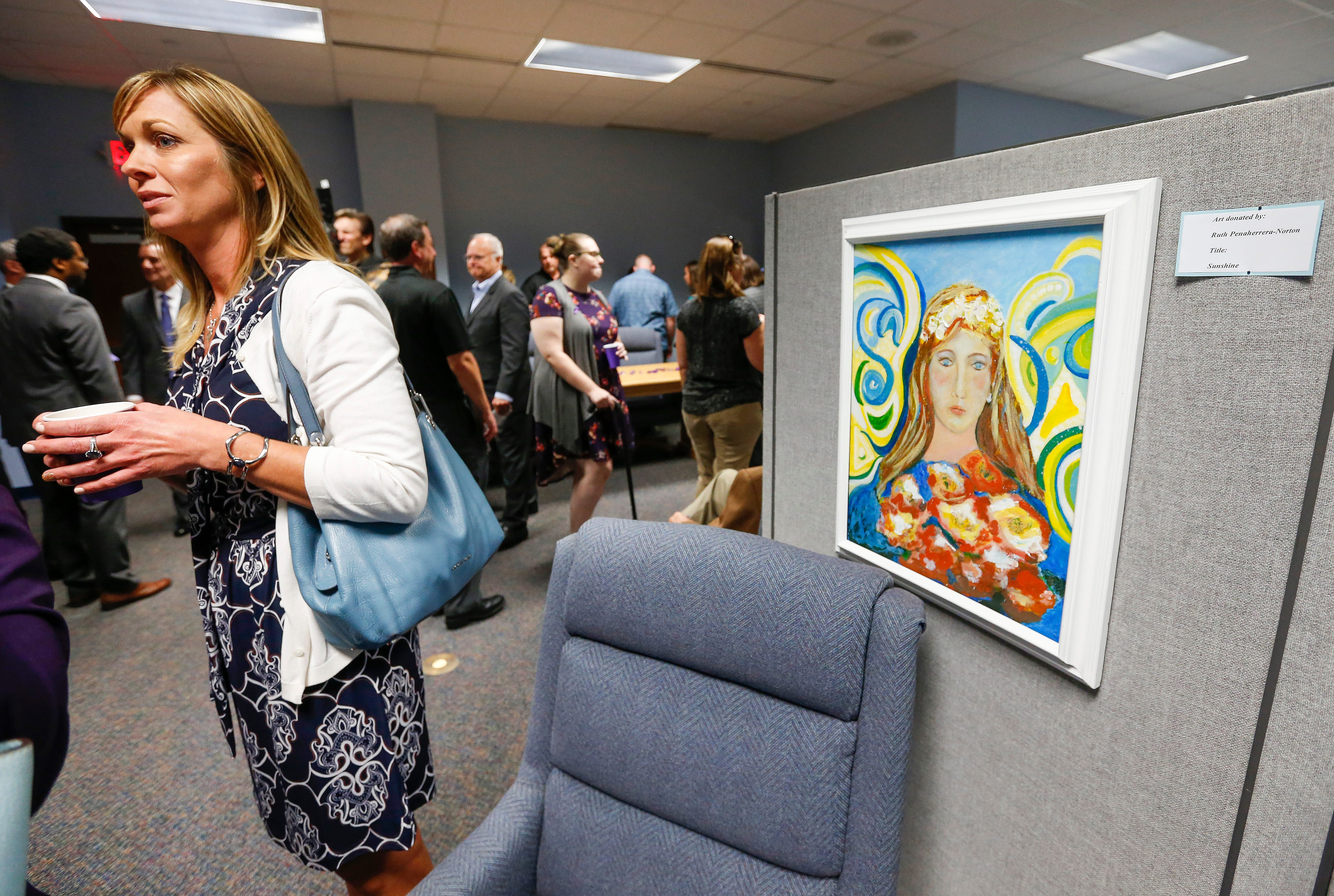 People tour the Family Justice Center located inside the Greene County Justice Center during its grand opening on Monday, Oct. 1, 2018.