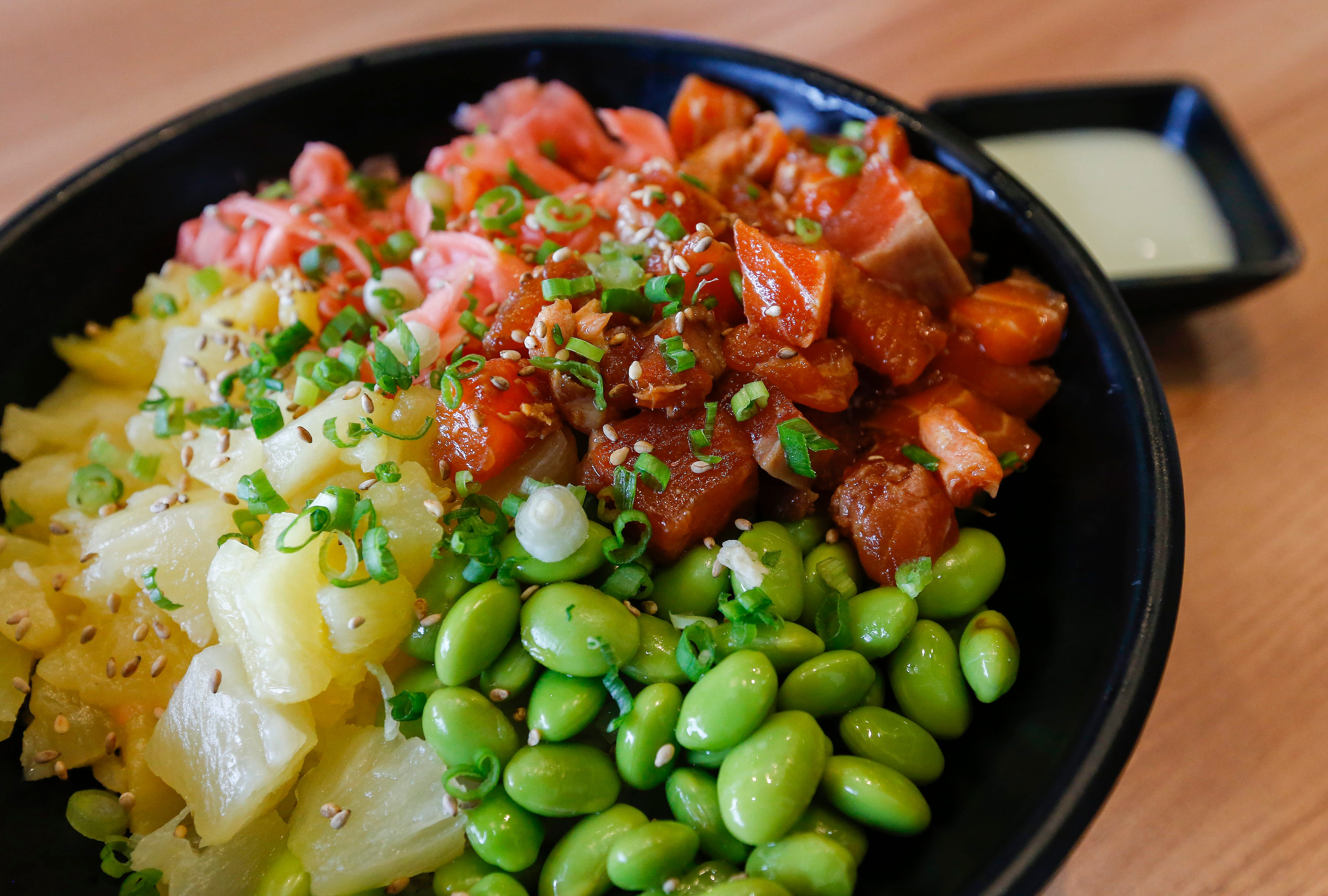 The salmon poke bowl with pineapple, edamame and ginger at Kuma Japanese Ramen & Sushi, which is located at 3405 E. Battlefield Road.