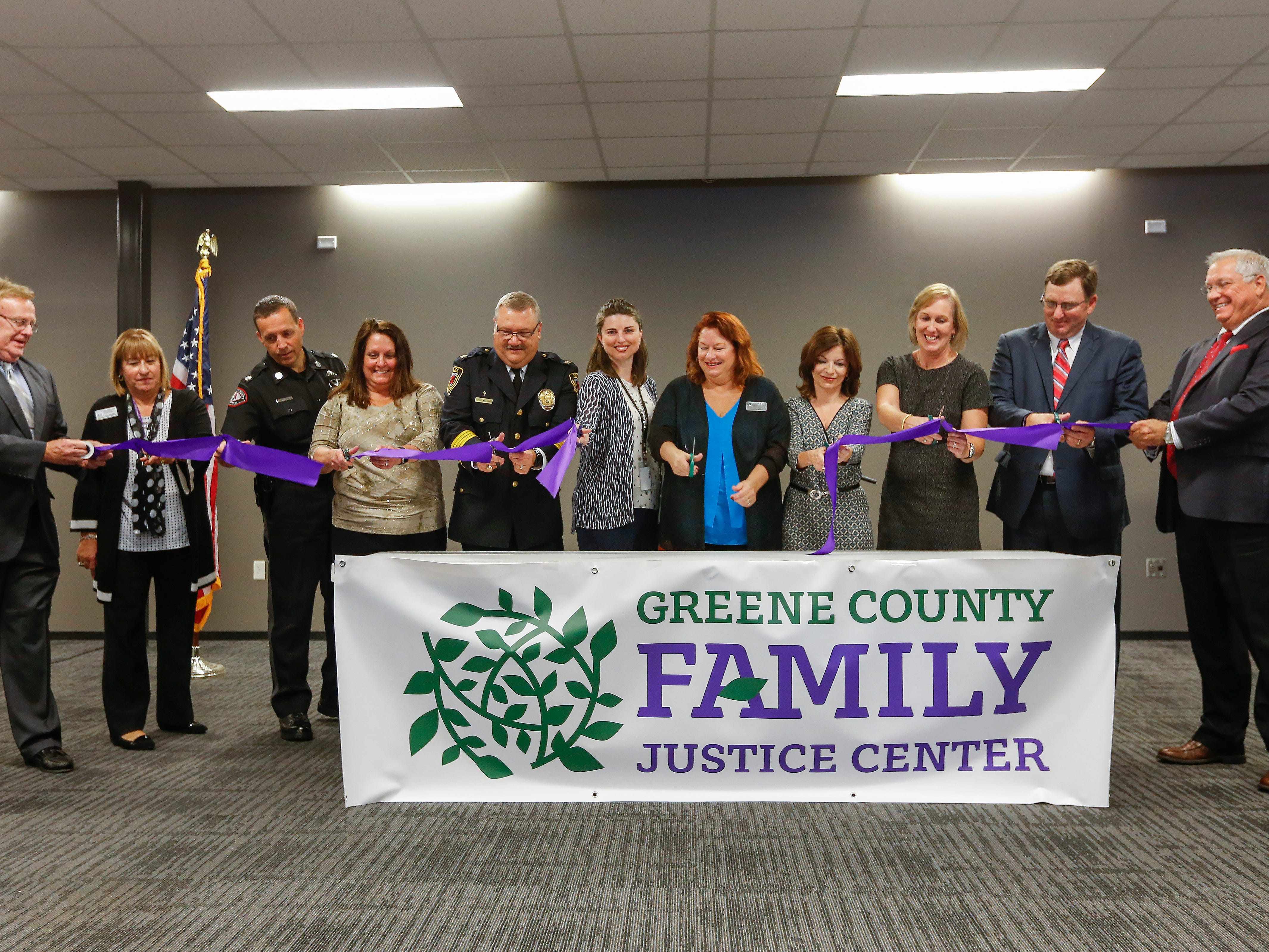 Springfield and Greene County officials along with victim advocates participate in the ribbon cutting ceremony for the Family Justice Center on Monday, Oct. 1, 2018.