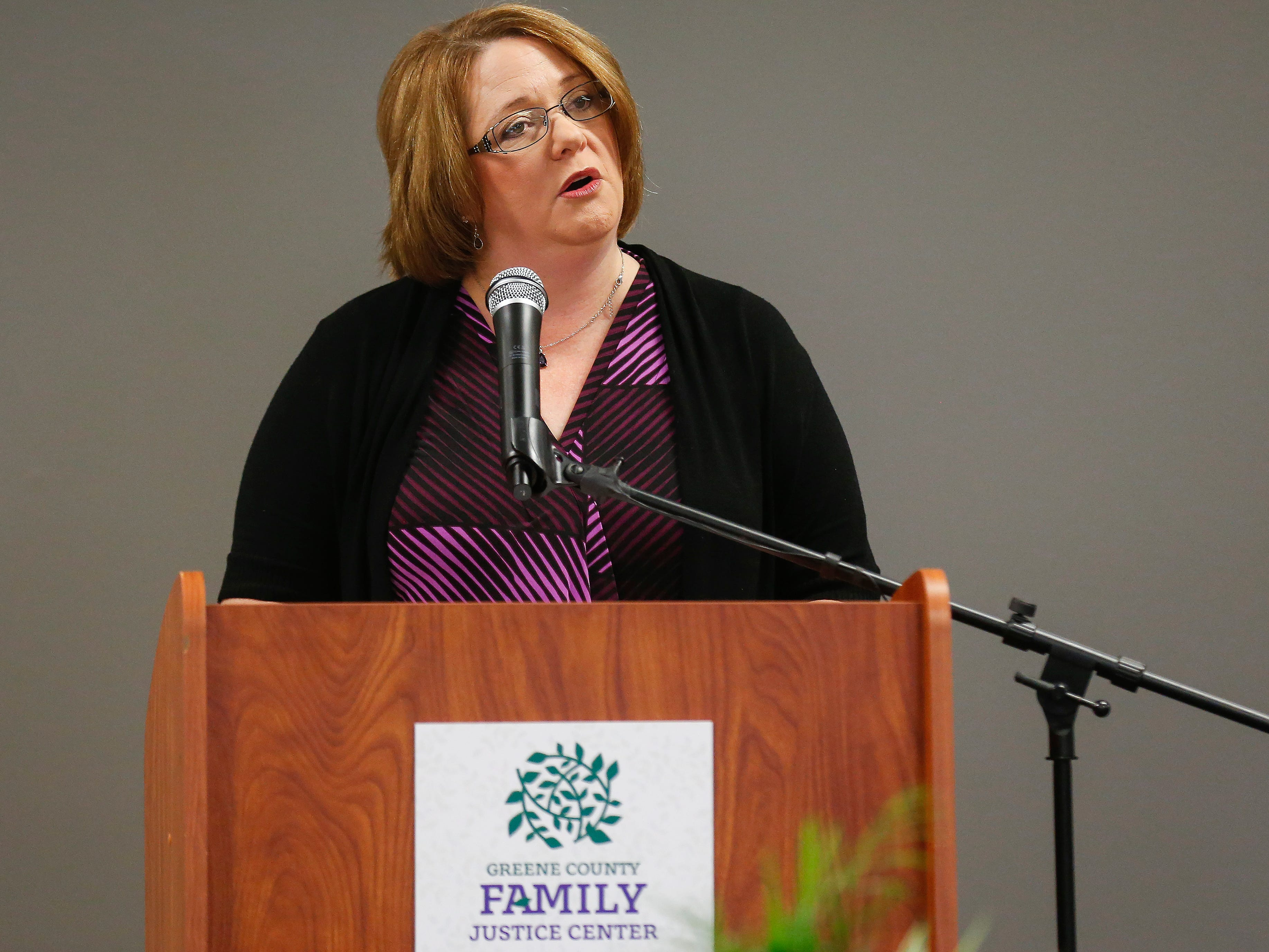 Lisa Saylor, a survivor of domestic violence and member of the Voices Committee, speaks during the ribbon cutting ceremony for the Family Justice Center on Monday, Oct. 1, 2018.