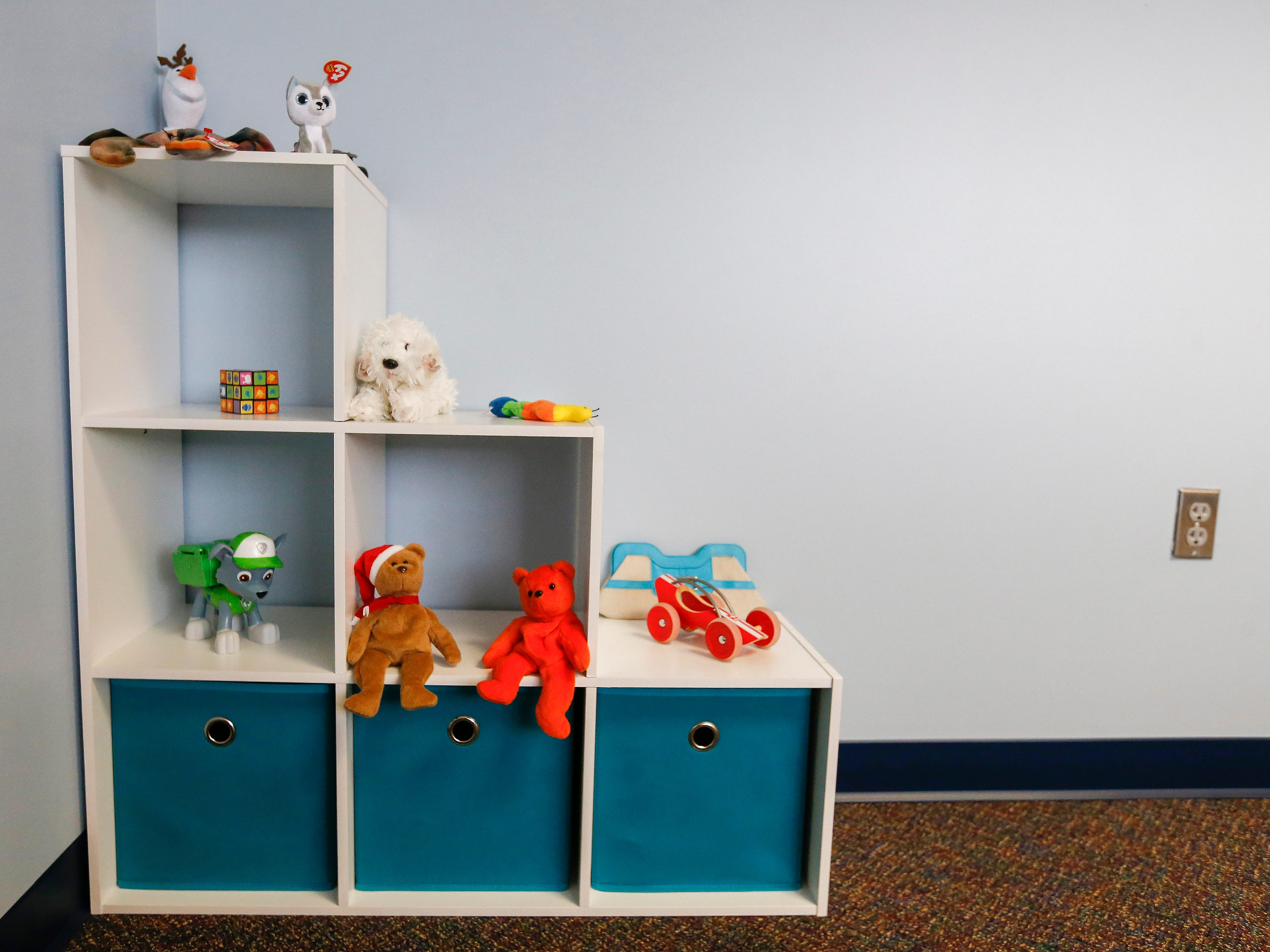 A shelf of toys sits inside one of the conference rooms at the Family Justice Center located inside the Greene County Justice Center.