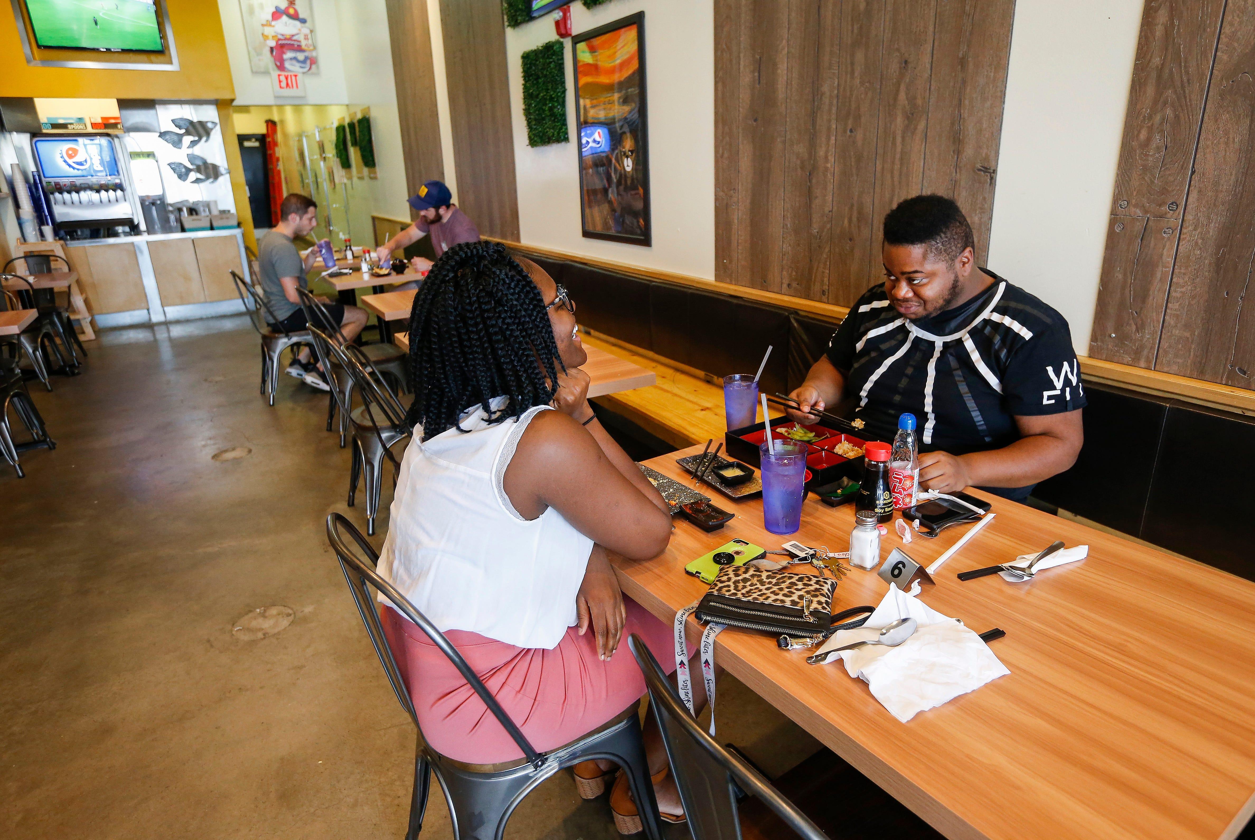 Customers enjoy lunch at Kuma Japanese Ramen & Sushi, located at 3405 E. Battlefield Road,  on Monday, Oct. 1, 2018.