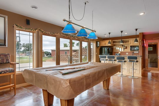 The downstairs centers around a wide open family room. It features a wet bar and kitchen area, and boasts ample space for a game of pool or any sort of entertainment.