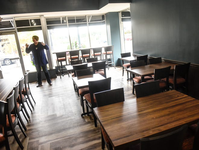 Donella Westphal talks about the new space and renovations Monday, Oct. 1, at Jules' Bistro in St. Cloud. The addition raises the restaurant's capacity from 33 to 75 people.