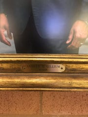 Nameplate of portrait of Mayor Andrew Gillum with misspelled last name at Tallahassee International Airport
