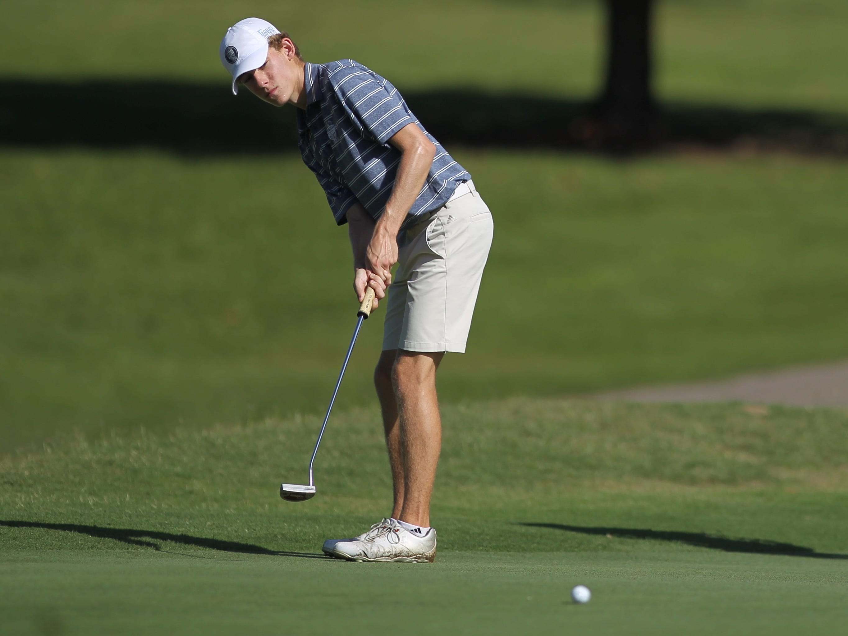 Maclay's Cole Miller putts during the boys golf City Championship at Hilaman Golf Course on Monday, Oct. 1, 2018.