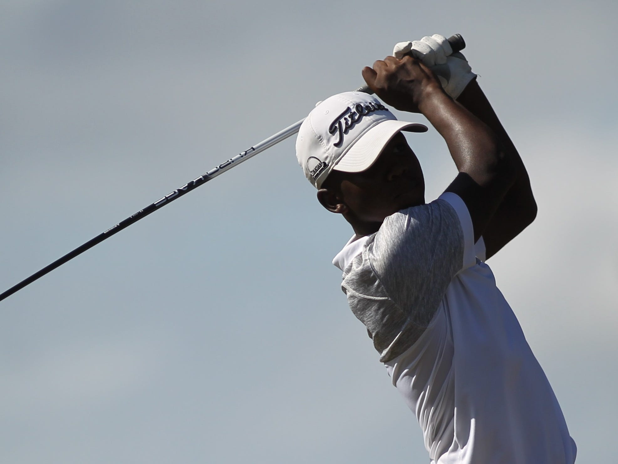 Leon junior Marquis Taylor watches a drive during the boys golf City Championship at Hilaman Golf Course on Monday, Oct. 1, 2018. Taylor shot a 1-under par 71 to tie for second.