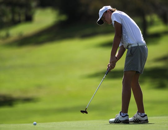 Chiles freshman Parker Bell putts at the boys golf City Championship at Hilaman Golf Course on Monday, Oct. 1, 2018. Bell won by six strokes with a 7-under par 65.