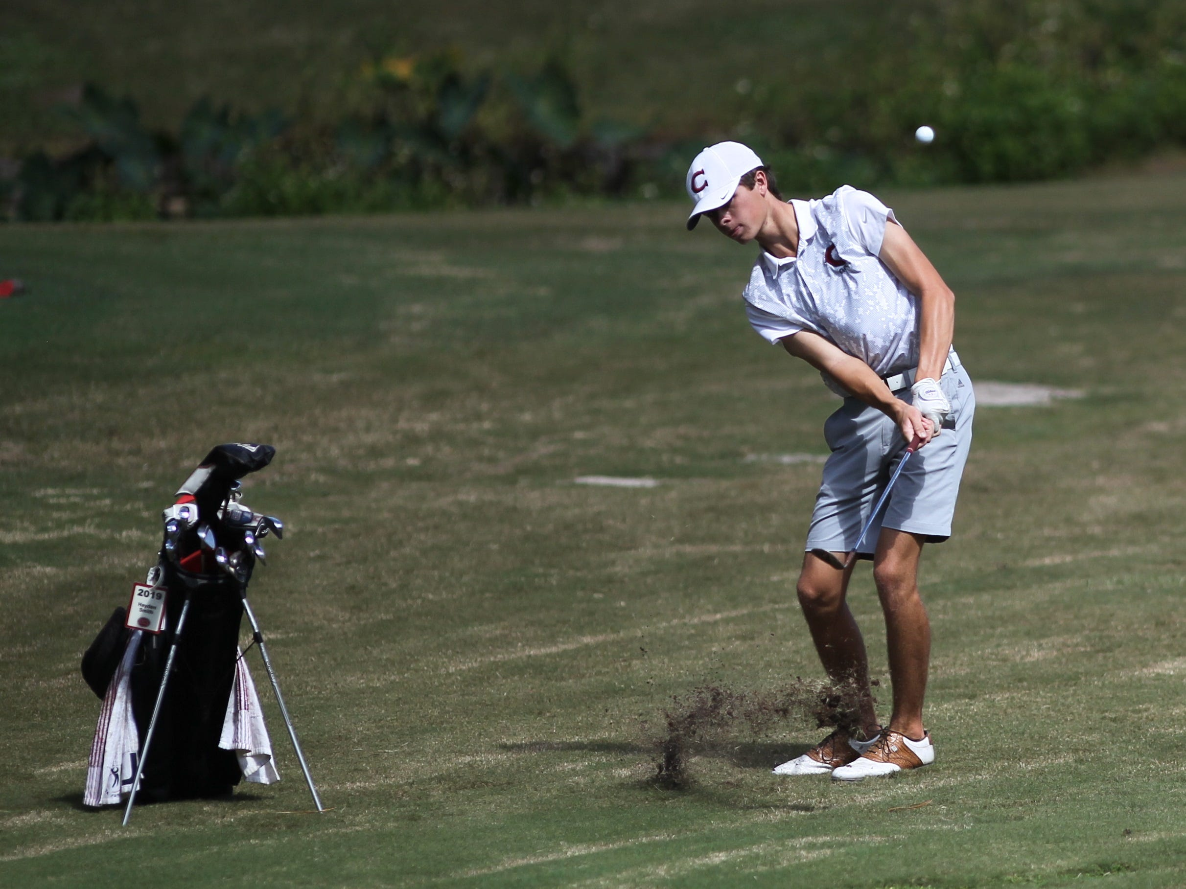 Chiles' Hayden Smith chips during the boys golf City Championship at Hilaman Golf Course on Monday, Oct. 1, 2018.