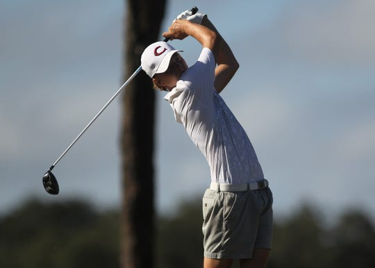 Chiles freshman Parker Bell watches a tee shot at the boys golf City Championship at Hilaman Golf Course on Monday, Oct. 1, 2018. Bell won by six strokes with a 7-under par 65.