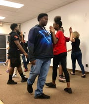 """Eric Howard and Kiora Wright rehearse a medieval dance for the Oct. 20 presentation of  """"A Wedding Knight To Remember."""""""