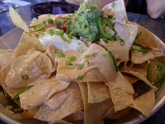 Nachos are an appetizer at BigShots Golf in Vero Beach. These have thin and crispy nacho chips topped with Pico de Gallo, guacamole, jalapenos, sour cream and queso cheese