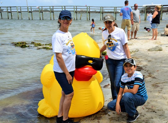 The Great Duck Derby is Sunday at Capt Hiram's Resort in Sebastian. Ester Ramos, Letty Perez and Elian Perez are pictured here at last year's derby.