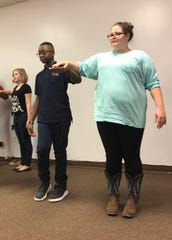 """Uriah Williams and Cerena Westberry rehearse a medieval dance for the Oct. 20 presentation of  """"A Wedding Knight To Remember."""""""