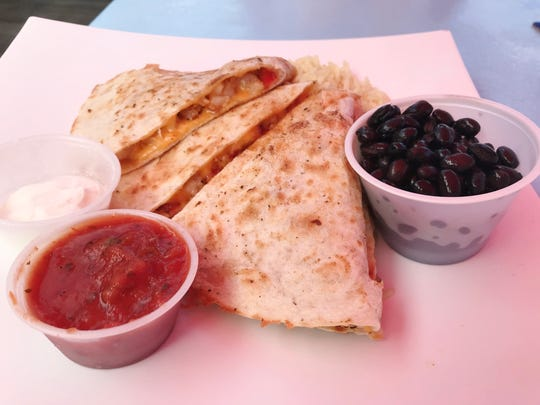 The lobster quesadilla at Harbor Cove Bar and Grill in Fort Pierce is warm tortilla was stuffed with chunks of tender, sweet lobster, cheddar cheese, onions and peppers, garnished with salsa and sour cream and served alongside tasty black beans and rice.