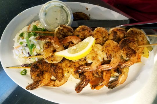 Dune Dog Cafe's Bourbon Street shrimp was 15 medium sized farm-raised shrimp skewered and coated in Cajun seasoning and lightly blackened. They were served with a choice of two sides.