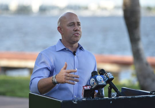Environmentalist activist Erin Brockovich and U.S. Congressman Brian Mast speak to a crowd at Flagler Park advocating for clean water on Sunday, September 30, 2018 in Stuart.