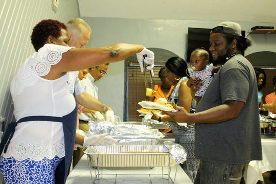 Banner Lake Community kitchen volunteers serve a southern banquet of homemade chicken, ham, collard greens, cornbread, macaroni and cheese, and pies prepared from food donated by House of Hope and Aldi supermarket on Family Day on Sept. 24.