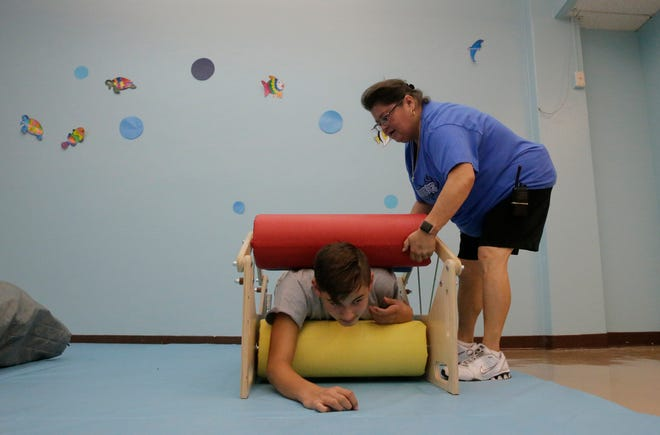 A Lincoln Middle School student uses the sensory room at the school.