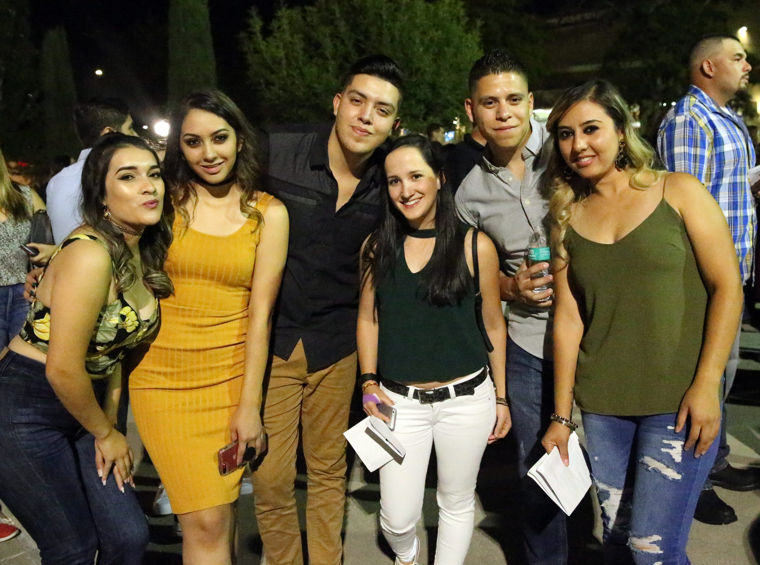 Stephanie Venegas, left, and friends outside the Don Haskins Center Sunday night.