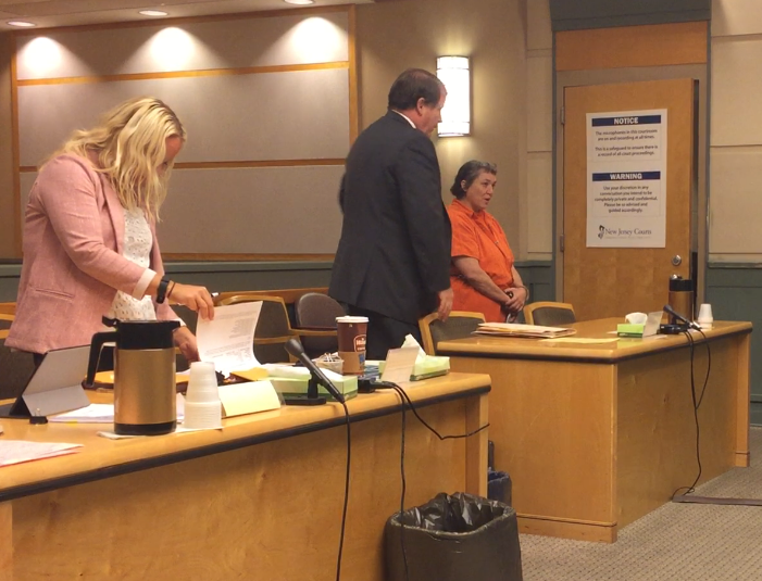 Stefanie S. Brown (far right, orange jumpsuit) was arraigned on murder and other charges at a hearing Monday in Cumberland County Superior Court. Brown is one of two people charged in the June 26 Vineland murder of William Coralluzzo. At left, county Assistant Prosecutor Cathryn Wilson.
