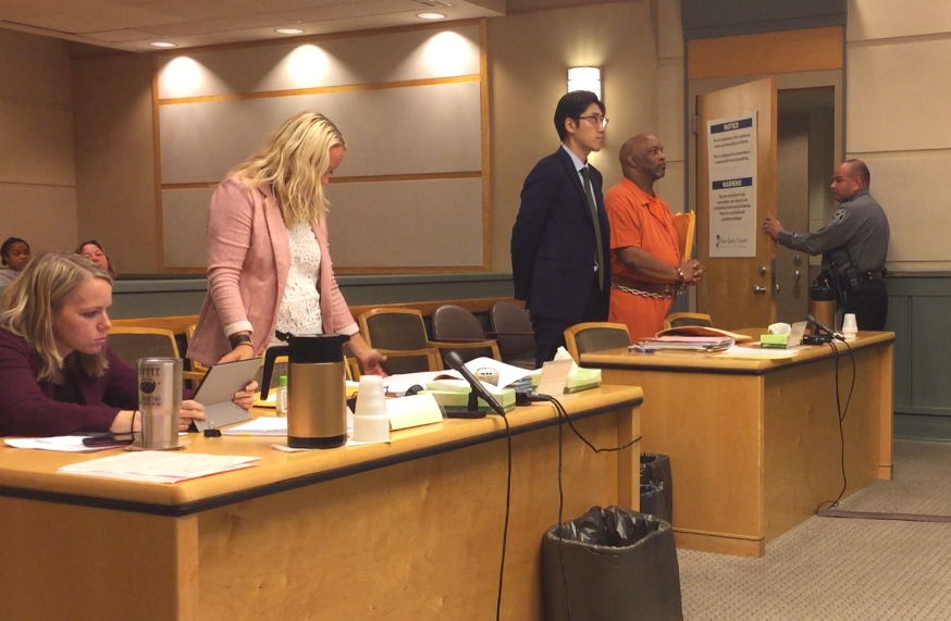 Floyd J. Freeman (far right, orange jumper) in Cumberland County Superior Court in 2018 with state Public Defender Andrew C. Moon. Assistant County Prosecutor Cathryn Wilson (left) is representing the state.