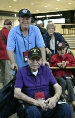 Veteran Cliff Dunlap poses for a photo with son Berry Dunlap before boarding a plane for the Central Valley Honor Flight 17 trip to Washington D.C. on Monday, October 1, 2018.