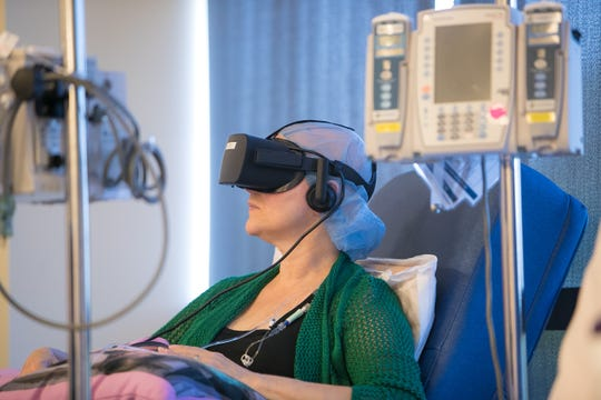 Cancer patient Kathleen Krakowski using an Oculus Rift virtual reality headset at the Helen F. Graham Cancer Center & Research Institute in Newark.