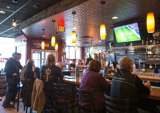 In this 2014 photo, patrons sit at the bar at Two Stones Pub in Kennett Square, Pa. Two Stones is planning a Middletown location later this year.