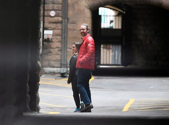 Minister of Foreign Affairs Chrystia Freeland and Gerald Butts, senior political advisor to Prime Minister Justin Trudeau, walk in the loading dock of the Office of the Prime Minister and Privy Council, in Ottawa on Sunday, Sept. 30, 2018.