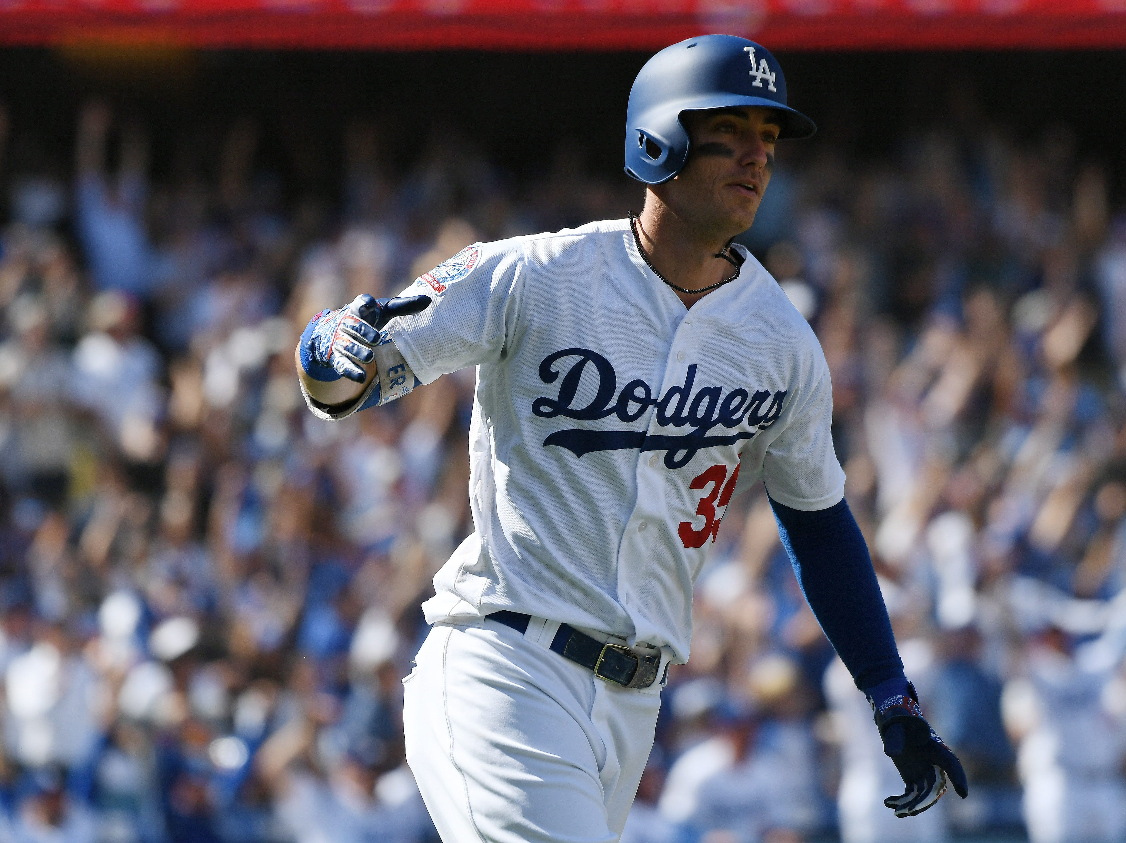 Cody Bellinger rounds the bases after his home run in the fourth inning.