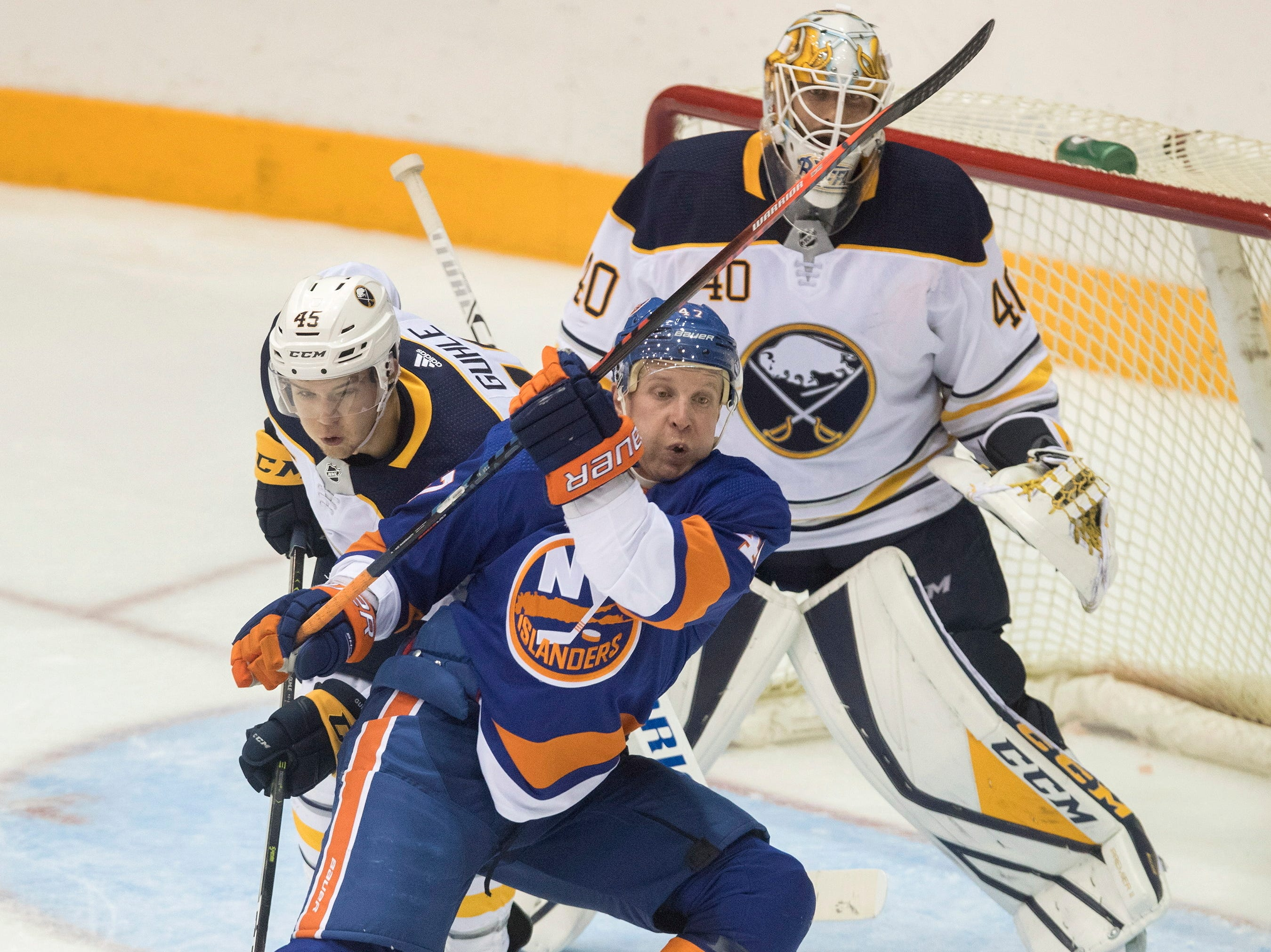 Sept. 28: New York Islanders' Leo Komarov, front, battles Buffalo Sabres' Guhle Brendan in the dying seconds of the third period