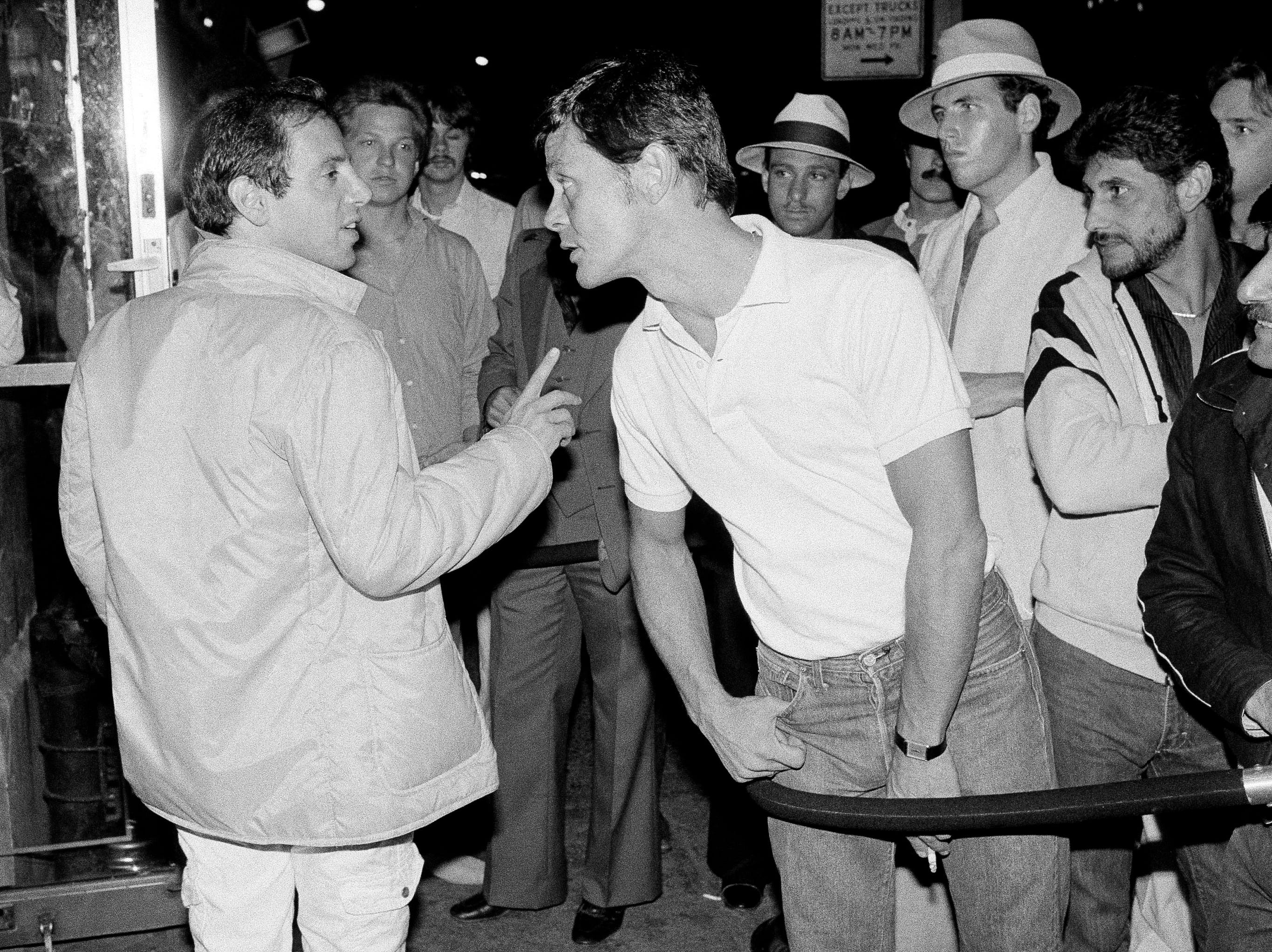 Studio 54 owner Steve Rubell, left, works the line at the door outside the disco, June 26, 1979.