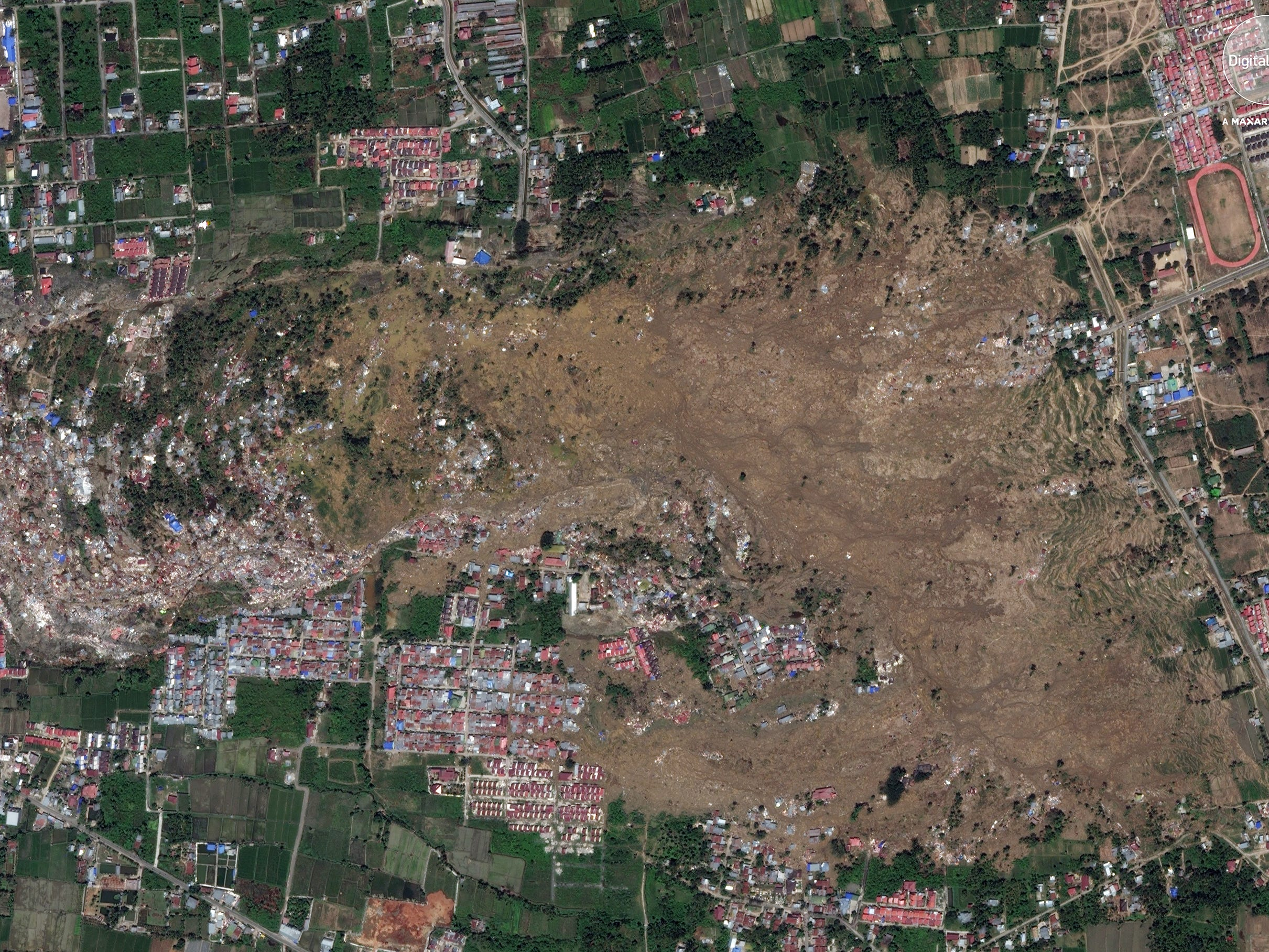 A satellite photo made available by DigitalGlobe shows Petobo, Palu, central Sulawesi, Indonesia, Oct. 1, 2018, after a tsunami hit the area.