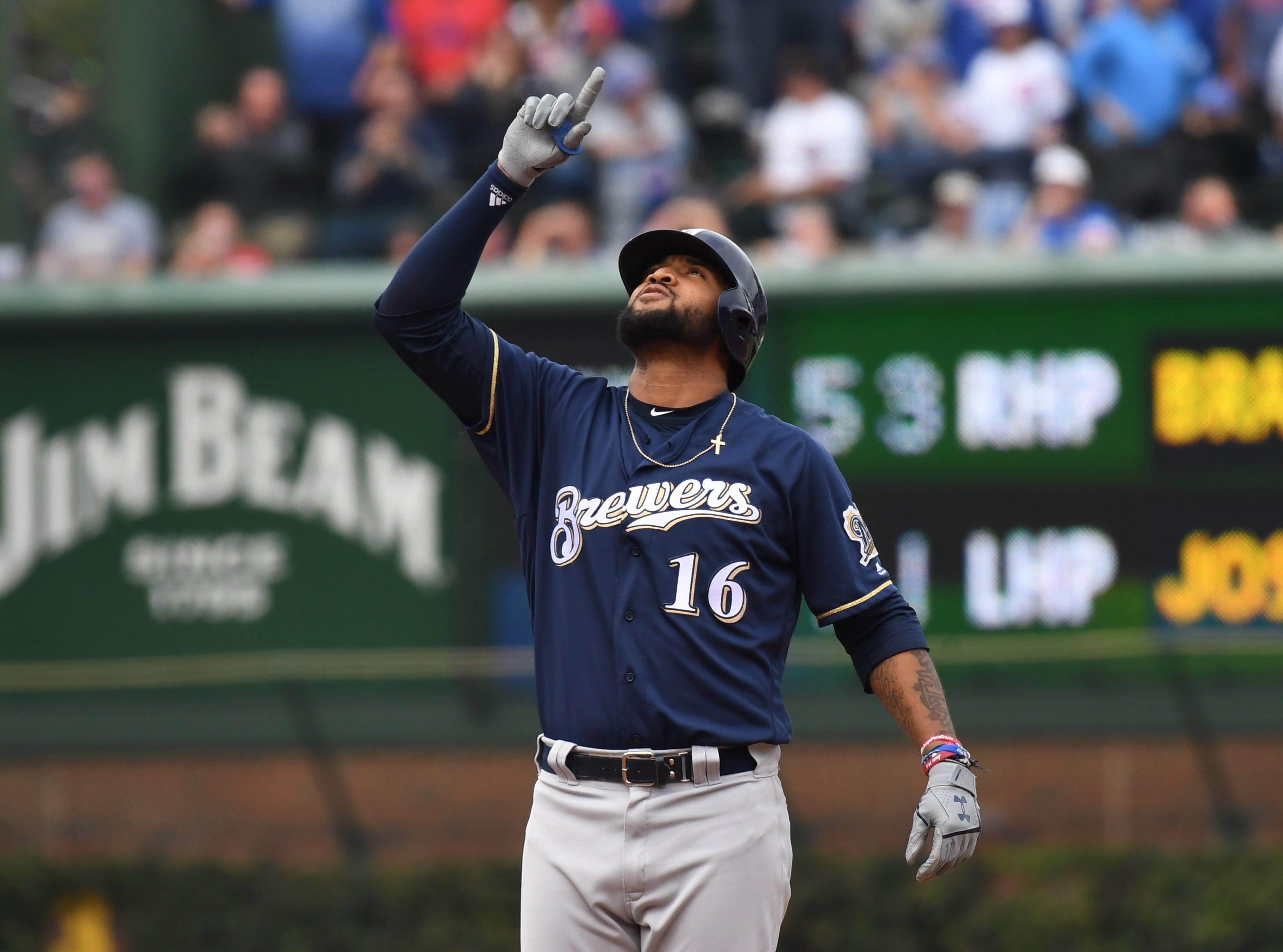 Milwaukee's Domingo Santana celebrates after hitting a double in the eighth inning.