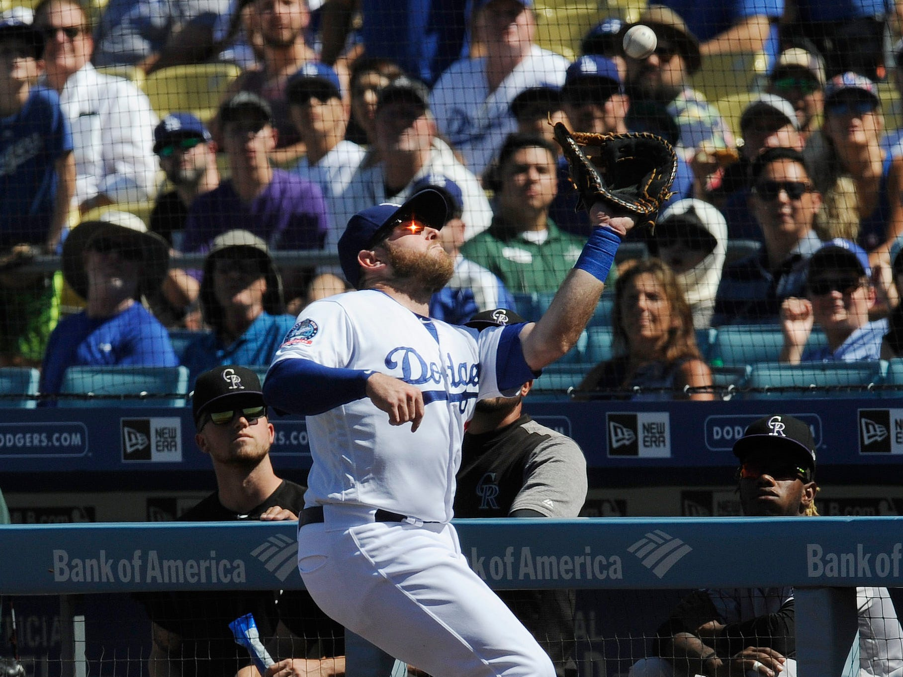 Dodgers first baseman Max Muncy makes a catch in foul territory in the second inning.