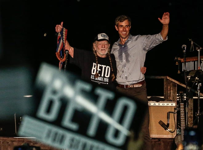 Texas candidate for the U.S. Senate Beto O'Rourke, right, along with country music legend Willie Nelson wave to supporters at a Turn Out For Texas Rally in Austin, Texas, Sept. 29, 2018. O'Rouke is running against Sen. Ted Cruz for Senate.