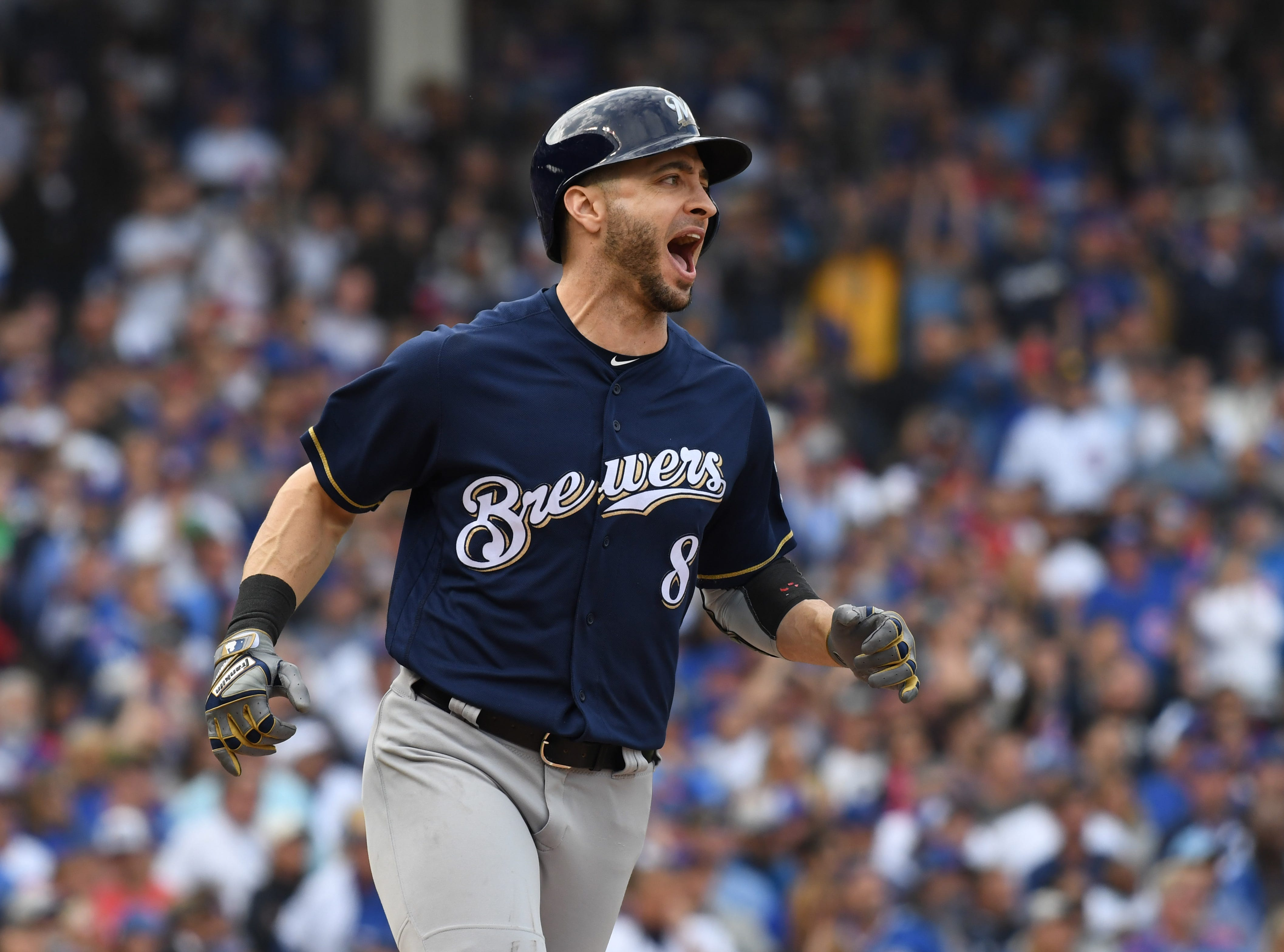 Brewers left fielder Ryan Braun reacts after hitting an RBI single in the eighth inning.