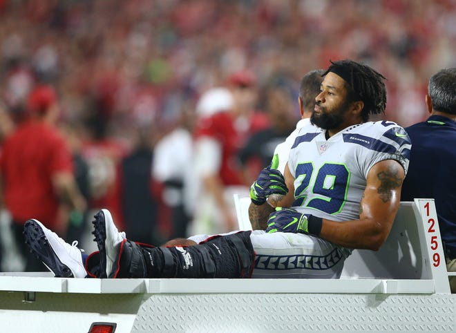 Seattle Seahawks safety Earl Thomas (29) leaves the field on a cart after suffering an injury in the fourth quarter against the Arizona Cardinals at State Farm Stadium.