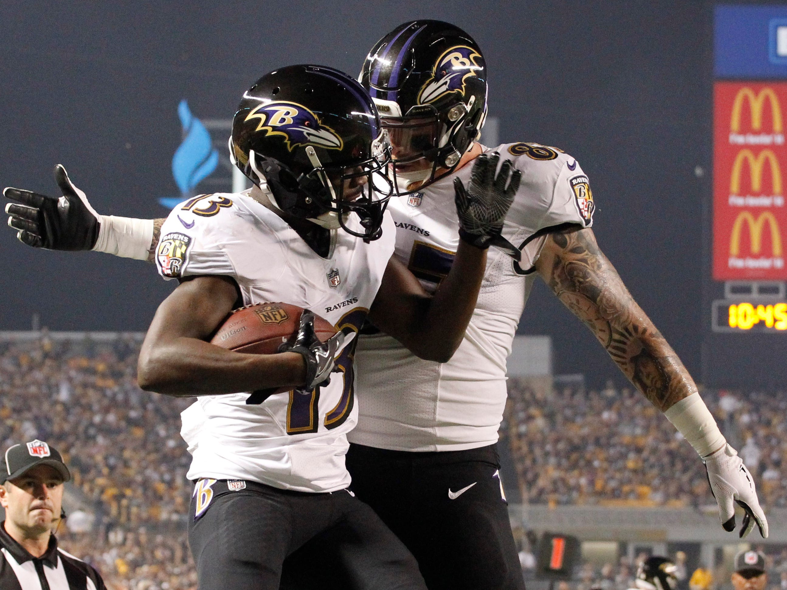 Baltimore Ravens wide receiver John Brown (13) celebrates his touchdown catch with Maxx Williams against the Pittsburgh Steelers during the first quarter at Heinz Field.