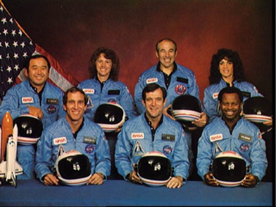 Crew members of space shuttle Challenger and mission STS-51 were: back row; Mission specialist Ellison S. Onizuka, from left, Teacher in Space Participant Sharon Christa McAuliffe, Payload Specialist Greg Jarvis and Mission specialist Judy Resnik. In the front row are Pilot Mike Smith, from left, Commander Dick Scobee, and Mission specialist Ron McNair. Challenger exploded shortly after liftoff on Jan. 28, 1986, killing all aboard.